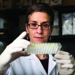 Assistant Professor Gillian Beamer of Infectious Disease and Global Health, poses for a photograph in a laboratory at Cummings School of Veterinary Medicine