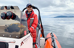Anjali Narasimhan, VG19, drives a zodiac research vessel, scanning the waters for humpback whales