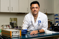 veterinary dermatologist Ramón Almela in the lab demonstrating a pen-like device used to administer cold plasma skin treatments