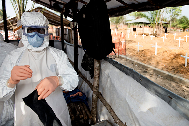 USAID personnel work on Ebola recovery in Liberia in 2015. Tufts will head a program that will work with 10 countries in Africa and Asia to halt the spread of emerging viruses that cause diseases like Ebola and COVID-19.