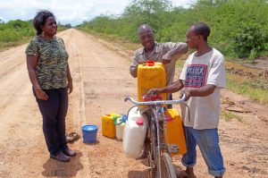 Dr. Amuguni talks with milk farmers in Tanzania to raise awareness about infectious disease.