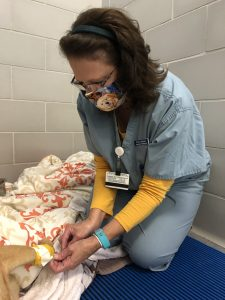 Donna Bloniasz taking care of a dogs leg in small animal wards