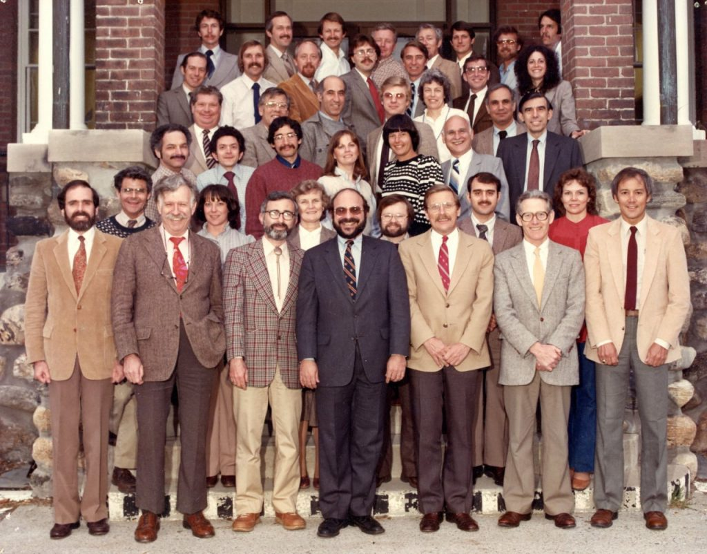 The group of faculty standing on the front steps of the Cummings School Administrative Building.  Young Dr. Jim Ross can be seen in the fourth row, second from right.