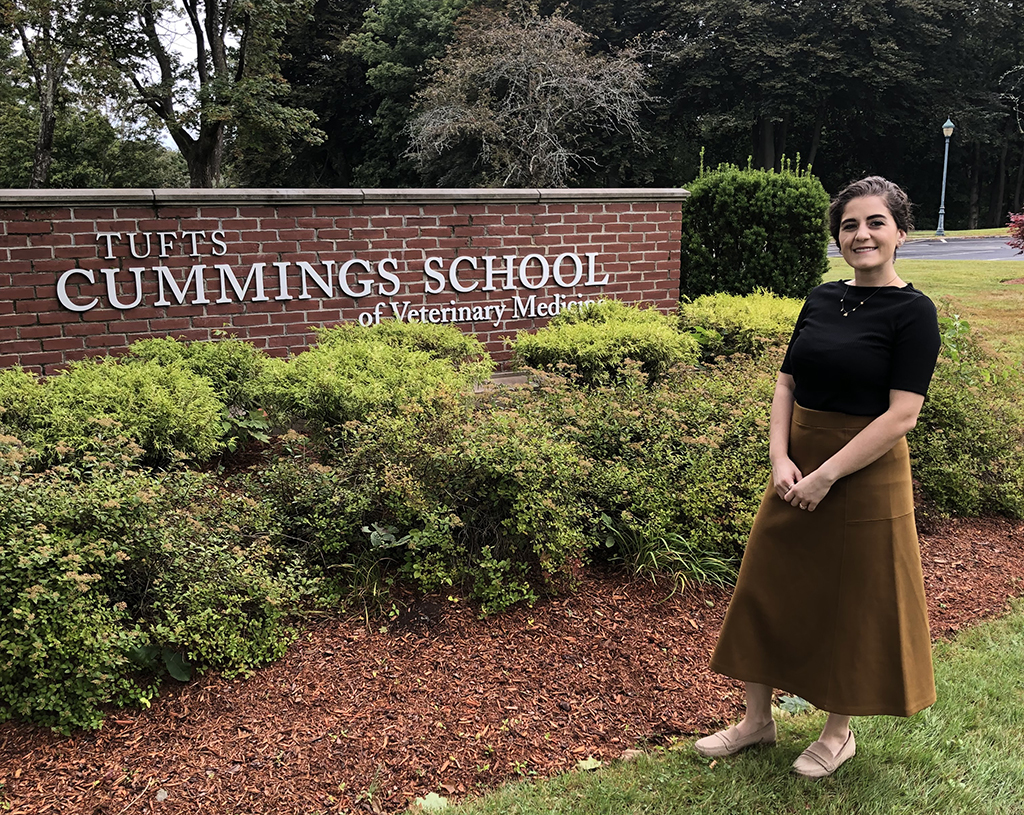 Elena Iacono standing in front of the Cummings School sign on the grafton campus posing for a picture
