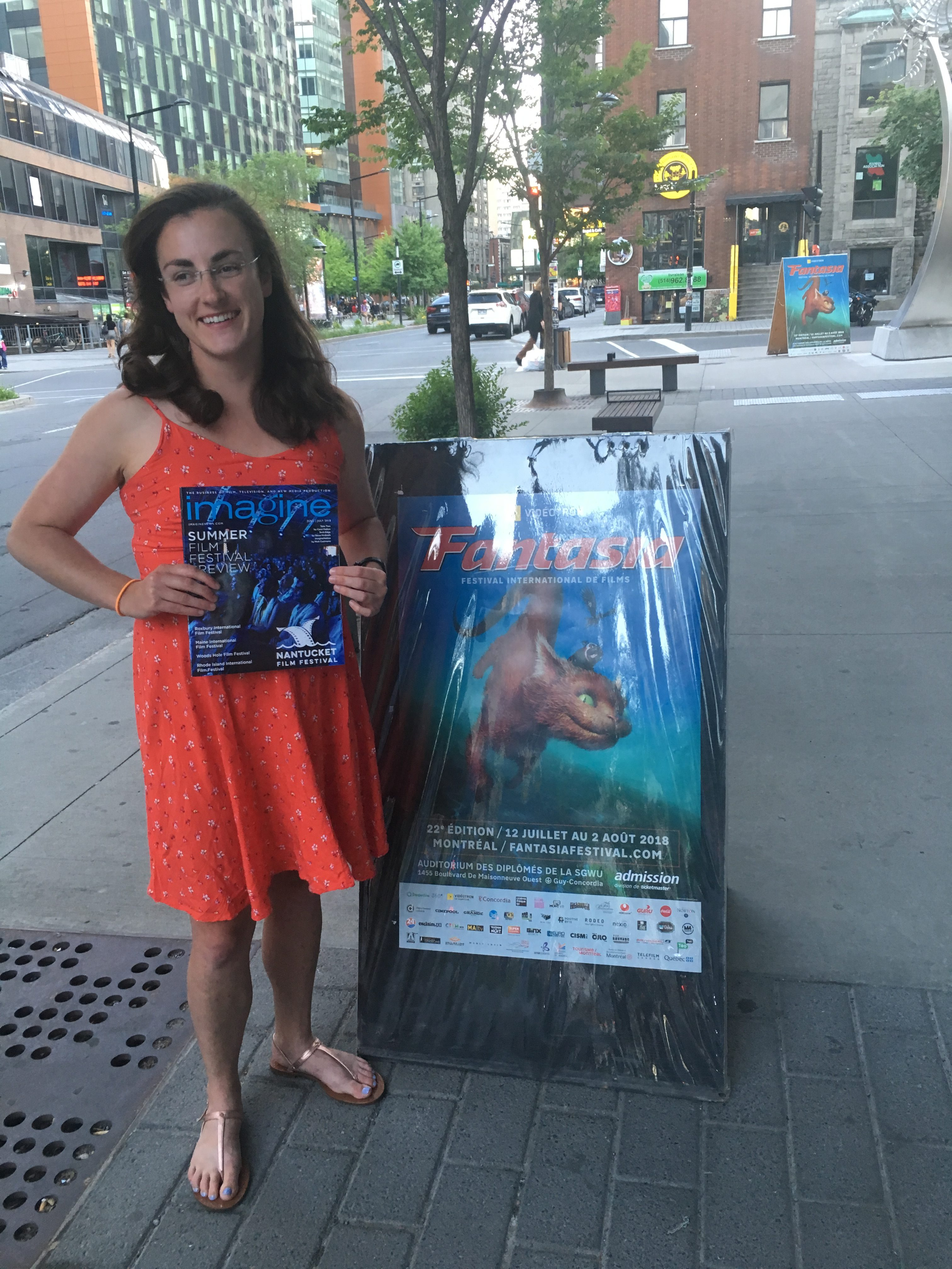 Mikhaila Waldman at Fantasia film festival holding a copy of the magazine she had her article published in during her MAPP externship experience