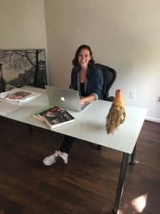Young - Farm Forward 2017 with chicken on desk