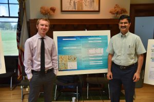 Dr. Sheoran with his mentee Mr. Dylan Champer, an MSIDGH student, who is presenting a poster on research project that he developed during the summer semester.