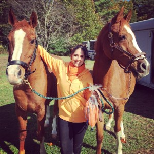 Brenna Pugliese with her 24-year-old Arabian gelding, Robbie (left), and her mom's Arabian gelding, Noble (right).