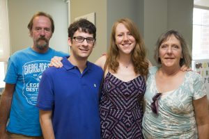 Megan (second from right) celebrates her graduation from the MS IDGH program with family and friends.