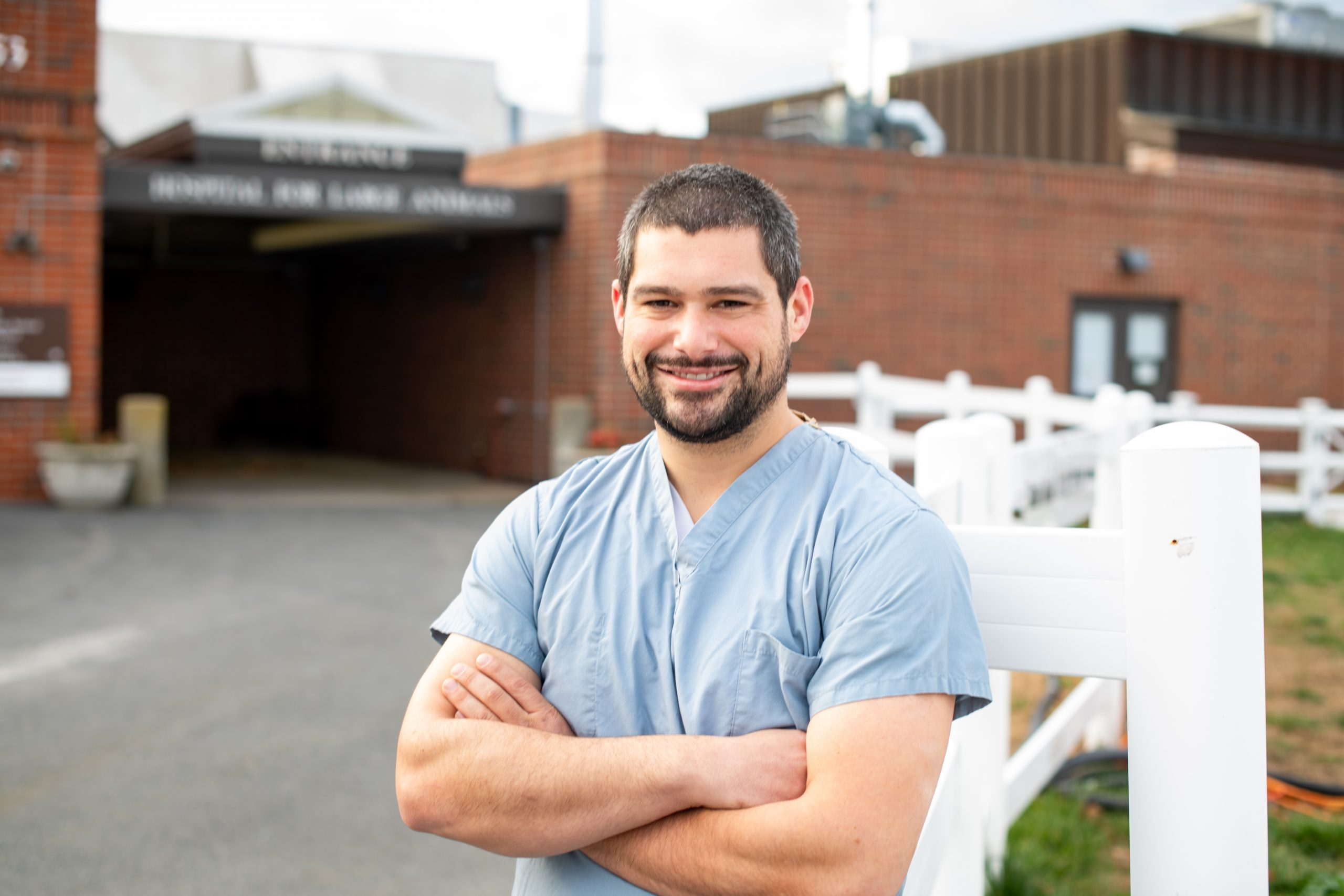 Joshua Peters, Diagnostic Imaging Technician, poses for a photo outside the Large Animal Hospital on campus at Cummings School of Veterinary Medicine at Tufts University on November 17, 2020.