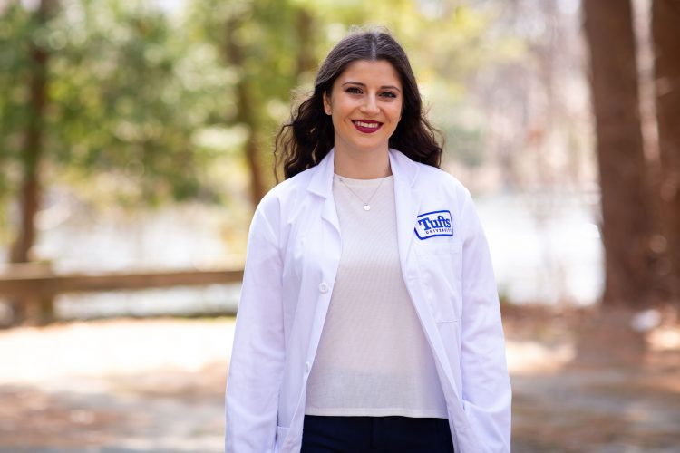 Tatyana Kalani, V21, posing for a picture in her medical white coat