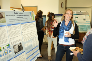 Esty presents her final research project at a poster session in October 2016.